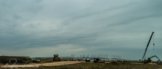 From the former rows of corn, a substation under construction appears